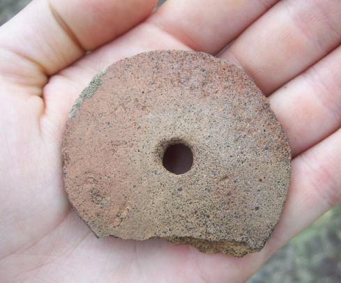 Ancestral Puebloan spindle whorl, a ceramic artifact used in making textiles.