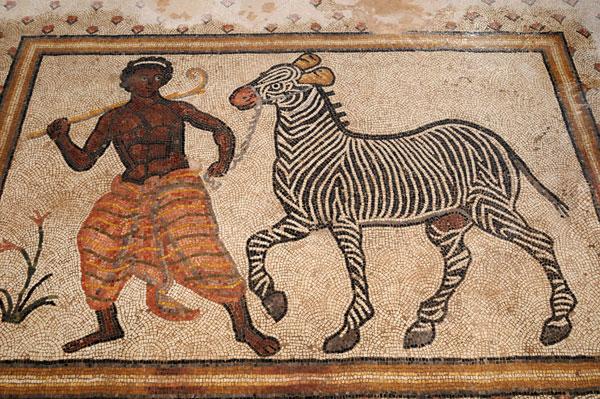 Black-man-leading-zebra-mosaic